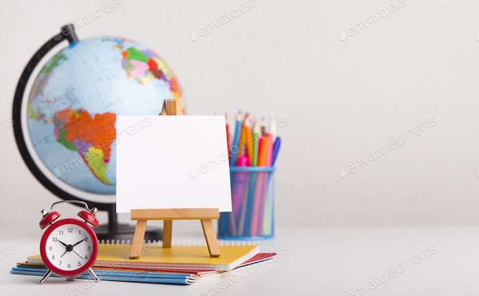 Office stationery with alarm clock on white background