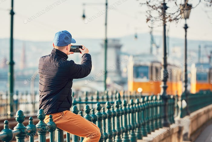 Tourist taking pictures with smart phone