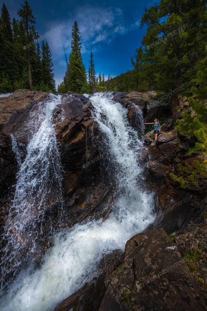 Backpacker near Jasper Creek Falls Colorado Indian Peaks Wildern