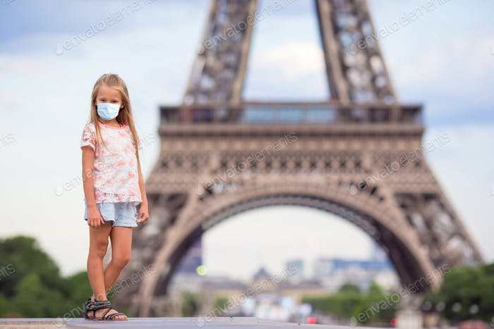 Adorable little girl in Paris background the Eiffel tower in France