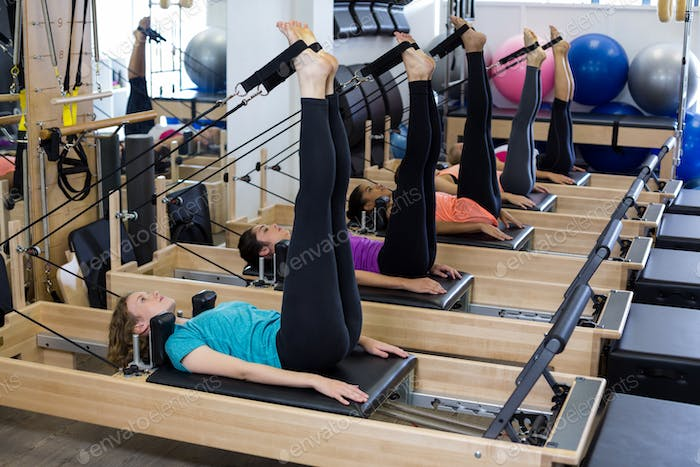 Group of women exercising on reformer