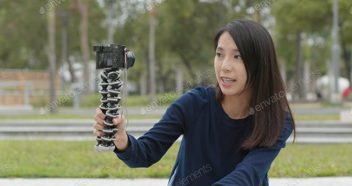 Woman taking a video fro vlog