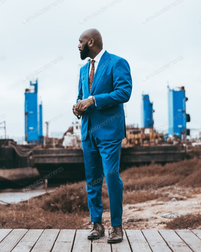 African man in an elegant blue suit