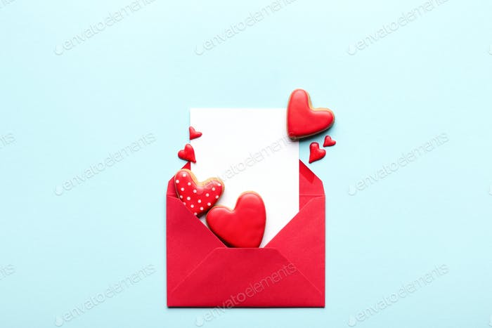 Red Envelope with Empty Card and Valentine's Cookies.