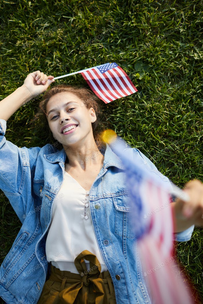 Relaxed high school girl with US stick flags