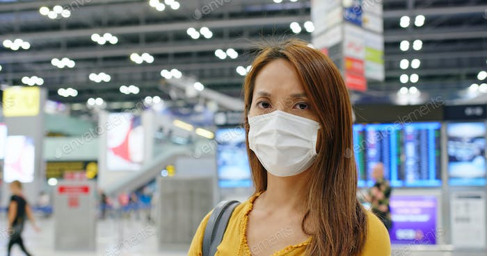 Woman wear medical mask at airport