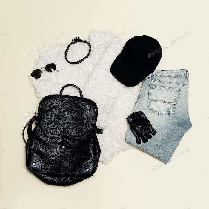 Black fashion set. Fur coat and black accessories. Bag, sunglass