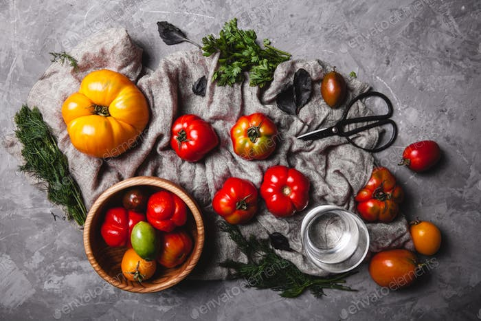 Fresh cherry tomatoes on wooden background
