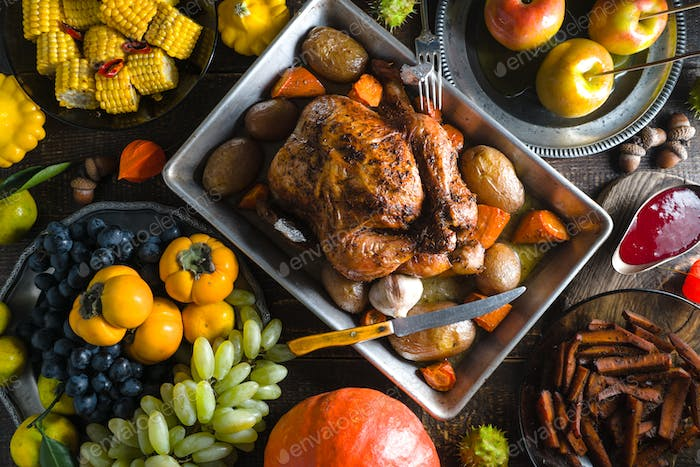 Feast with turkey on Thanksgiving, vegetables and fruits