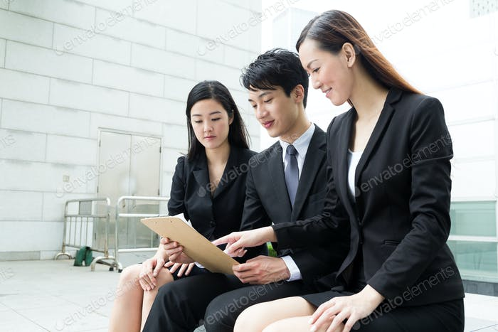 Group of the business people read on the information