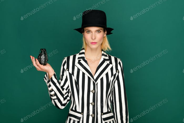 Trendy woman in striped jacket with grenade