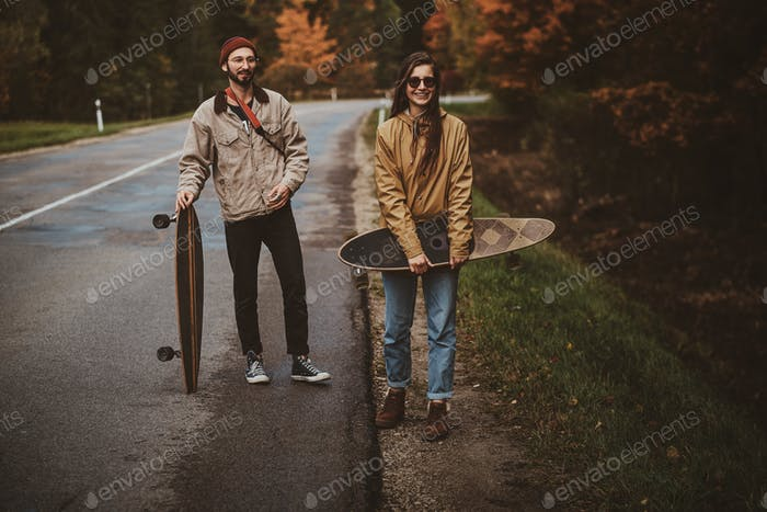 Young romantic couple are walking on the sideroad