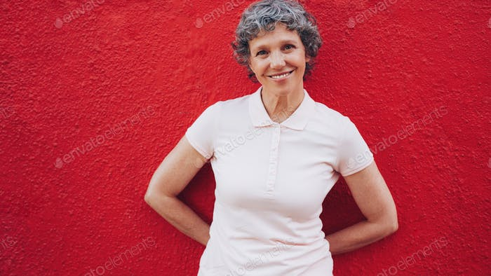 Happy middle aged woman standing relaxed