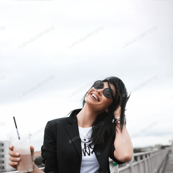 brunette girl keeping takeaway drink