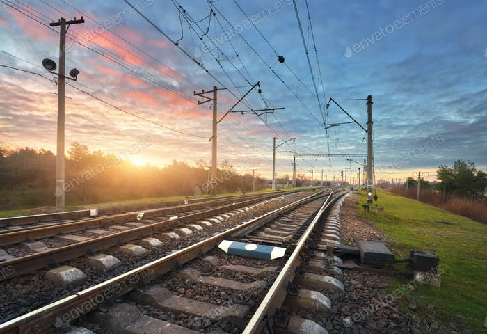 Railway station against beautiful sunny sky. Industrial landscap
