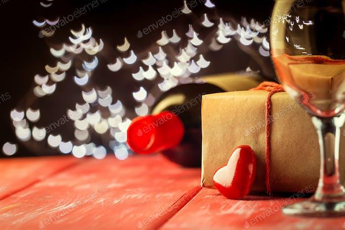 Valentinstag Hintergrund von Wein und Kerze