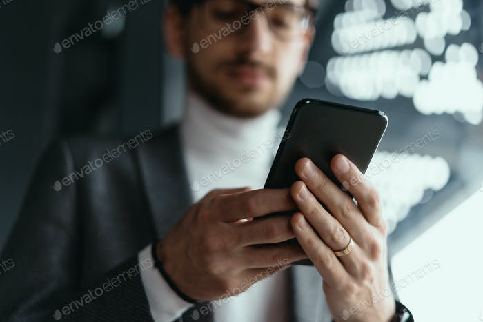 Portrait successful business texting on the smartphone
