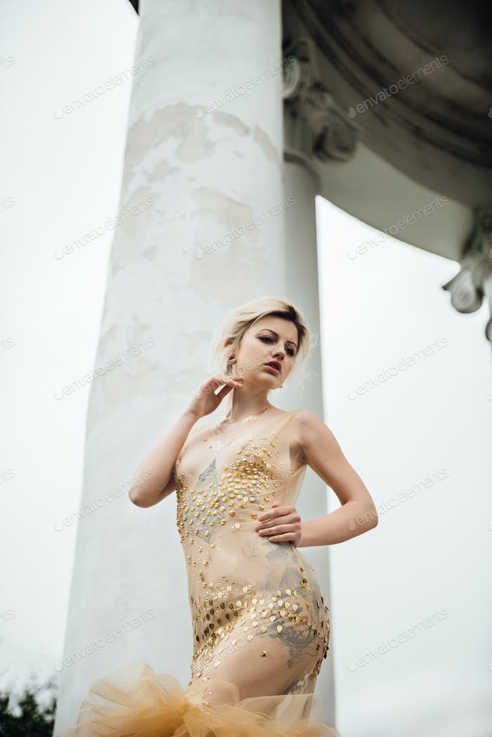 model girl in dress gold angel
