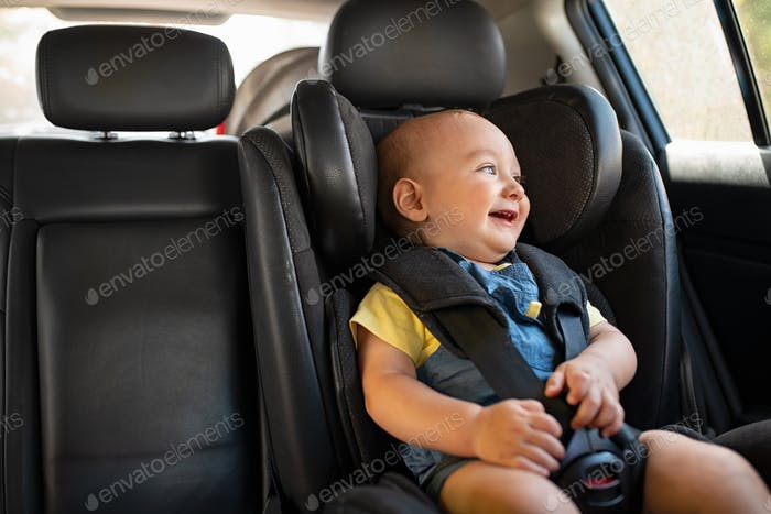 Toddler sitting in car during road trip