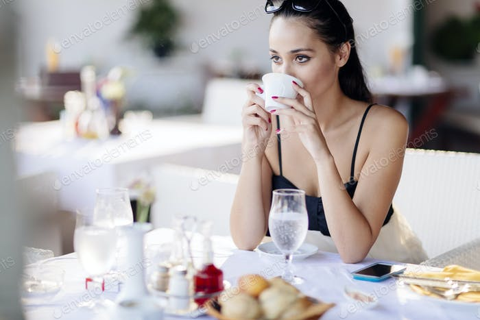 Beautiful women drinking tea in restaurant