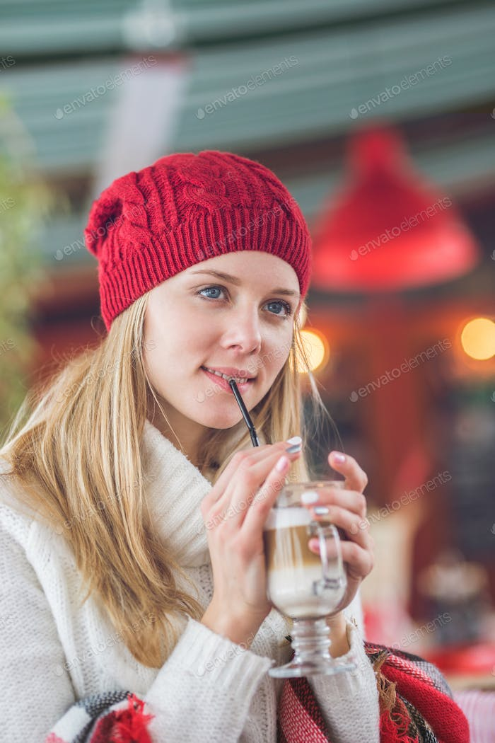 Attractive young girl drinking coffee