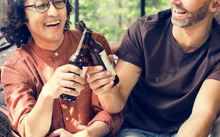 Diverse friends drinking beers together