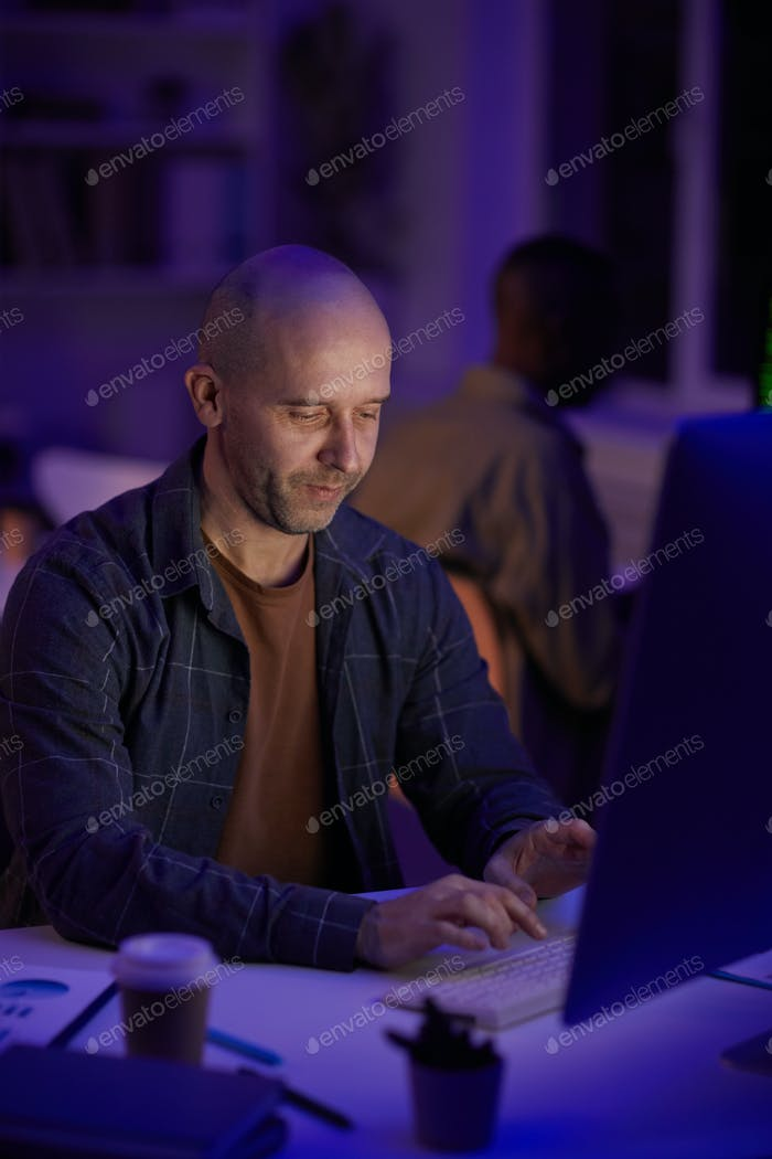 Mature Man Concentrated On Work
