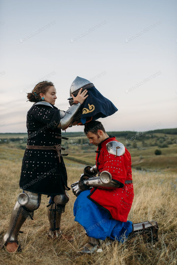 Woman wears a helmet to medieval knight