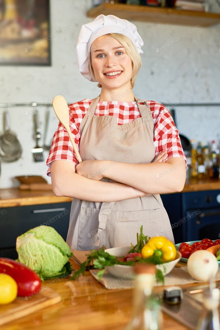 Pretty Young Housewife in Chefs Hat