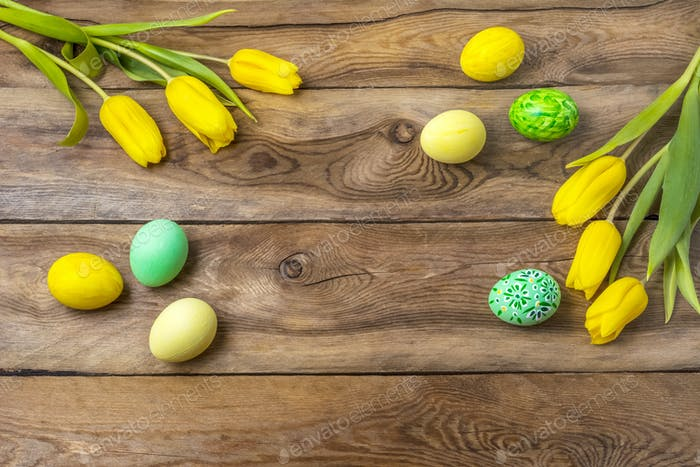 Easter yellow green eggs and tulips, copy space