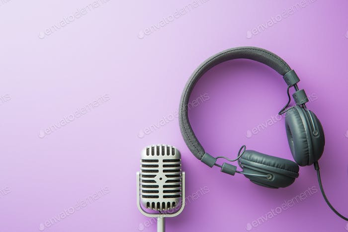 vintage silver microphone and headphones