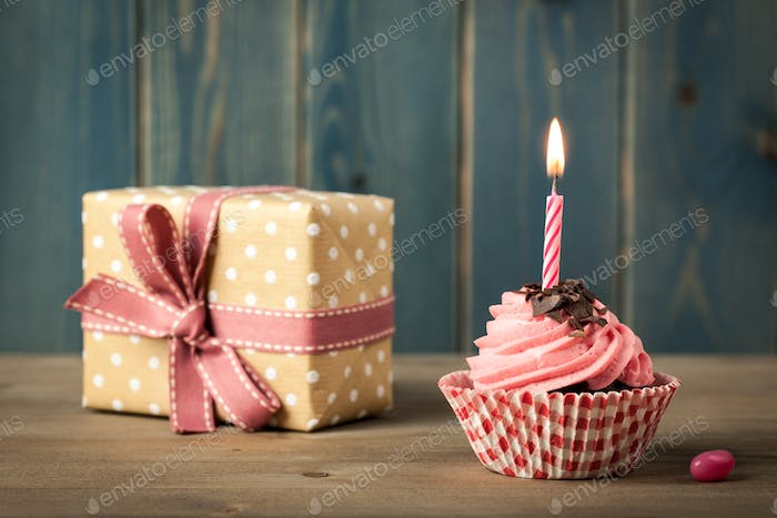 Homemade Birthday cupcake with candle and gift box