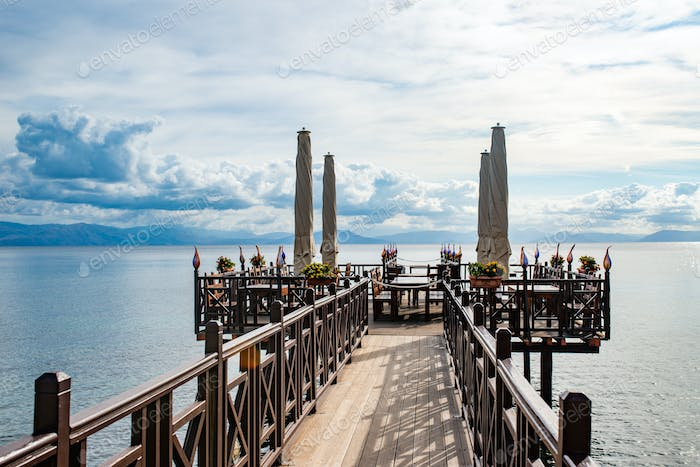 Wooden pier with cafe in Ionian sea. Greece