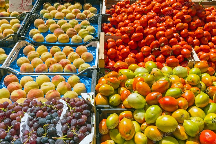 Tomatoes, grapes and peaches for sale