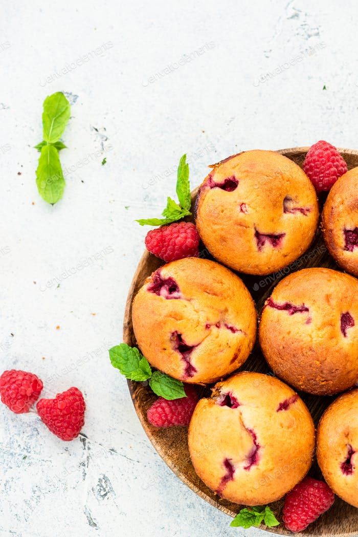 Homemade Raspberry Muffins on Wooden Plate