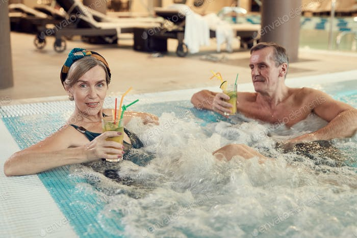 Modern Senior Couple Enjoying Hot Tub at Resort