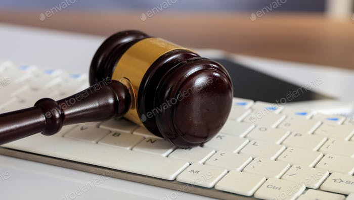 Auction or Judge gavel on a computer keyboard