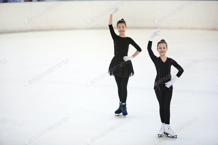 Two Figure Skaters Posing in Competition