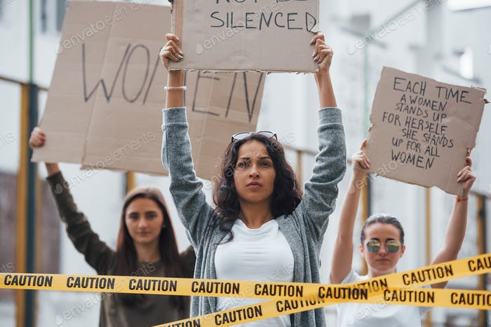 Horizontal shot. Group of feminist women have protest for their rights outdoors