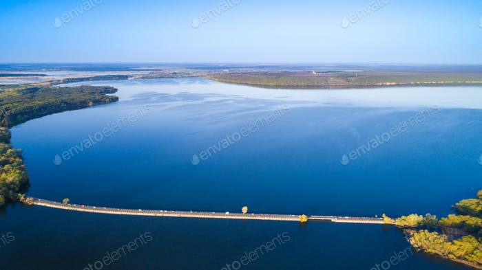 Flying over the river dam. Aerial camera shot. Ukraine