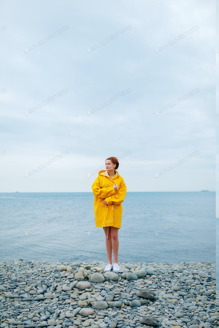 Girl wearing yellow raincoat