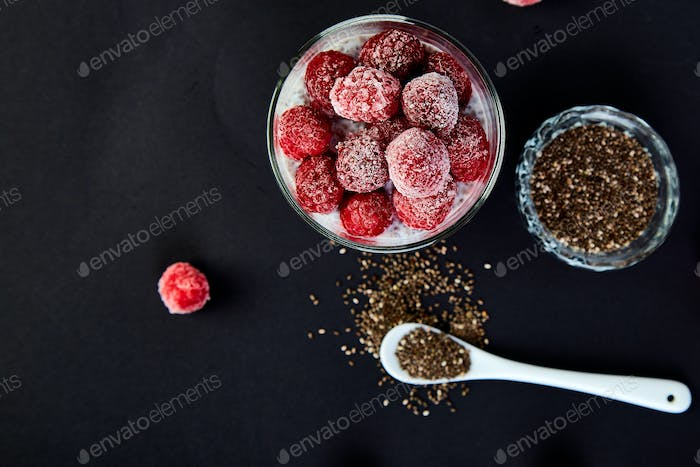 Healthy chia pudding with raspberries in glass
