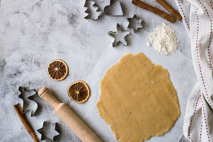 Cooking Christmas gingerbread cookies on a gray background