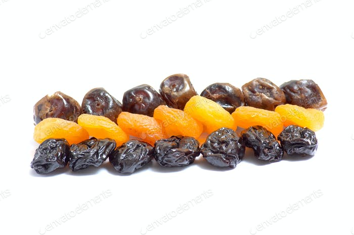 Composition from dried fruits on a light background.