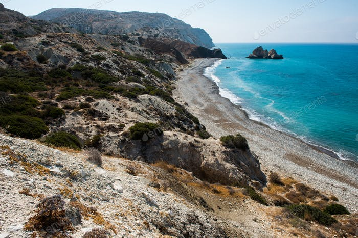 Aphrodite's rock. Rocky coastline on the Mediterranean sea in Cyprus. Petra tou Roumiou