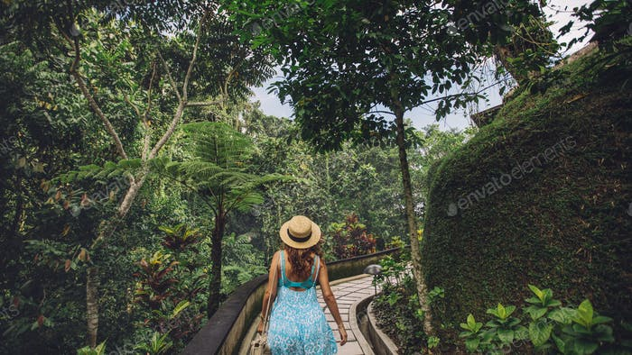 Female tourist in tropical garden