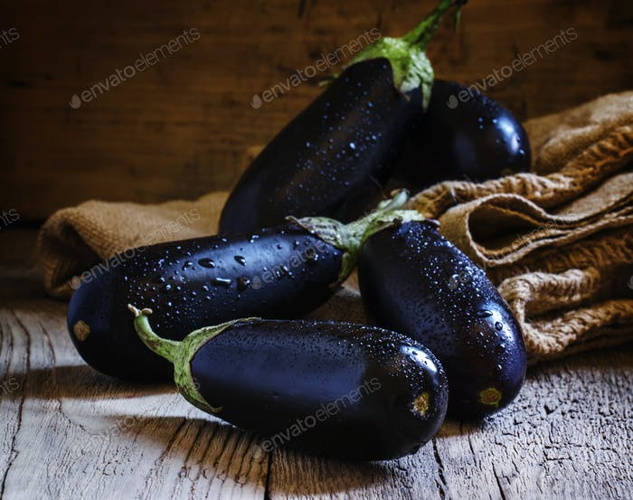 Purple eggplants in a canvas bag