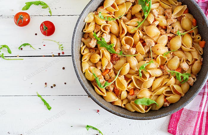 Italian pasta shells with meat and tomato sauce. Conchiglie pasta. Top view