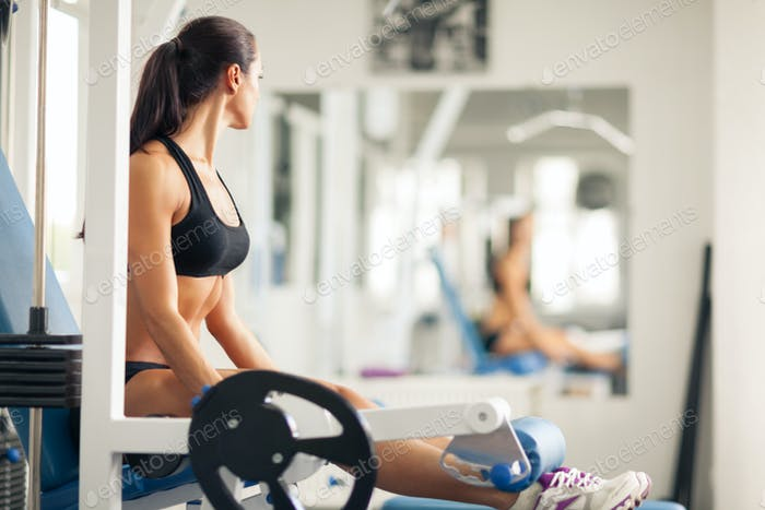 Athletic woman working out in gym