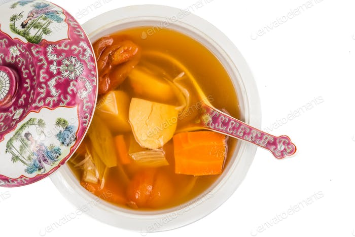 Casserole of Chinese potato carrot onion soup isolated in white